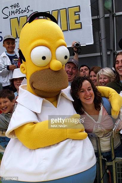 A mascot dressed as Homer Simpson grabs puts his arm arround a woman 25 July 2007 at the British Premiere of ' The Simpsons Movie at the Dome in...