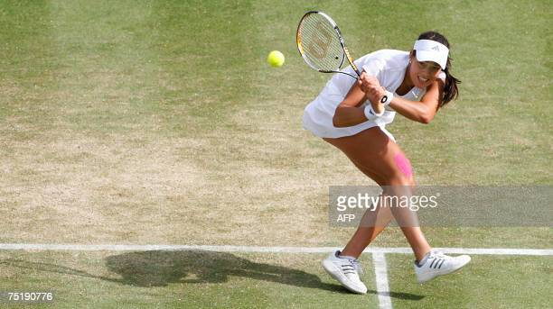 Ana Ivanovic of Serbia returns the ball to Venus Williams of USA during the semi finals of the Wimbledon Tennis Championships in Wimbledon in south...
