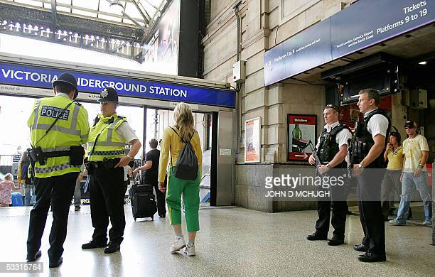 Armed and unarmed police officers patrol Victoria Station in London 02 August 2005 on the day Britain's Prime Minister Tony Blair said a taskforce...