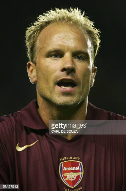 Arsenal's Dennis Bergkamp appeals after he is given a yellow card during his premiership match against Fulham at home to Arsenal at Highbury football...
