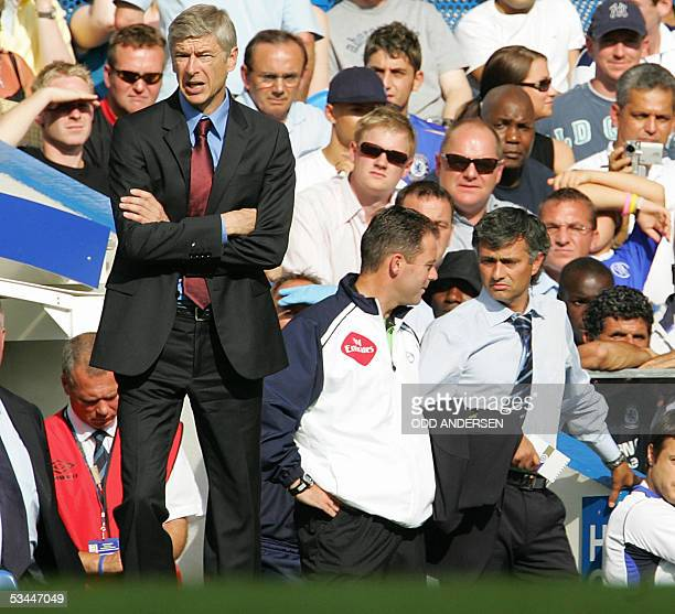 Arsene Wenger manager of Arsenal and Chelsea counterpart Jose Mourinho watch their teams during a premiership match at Stamford Bridge in west London...