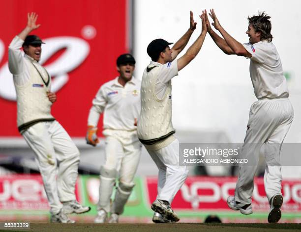 Australian bowler Glenn McGrath celebrates with teammates after dismissing England's Ian Bell on the fifth day of the fifth and final NPower Ashes...
