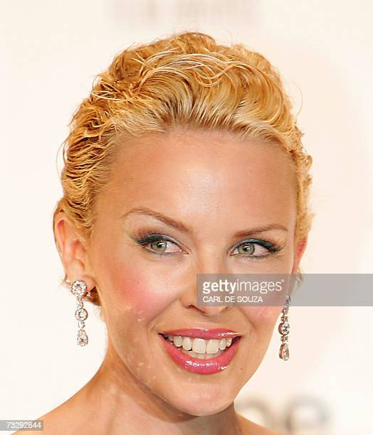 Australian pop singer Kylie Minogue poses for pictures during the British Academy of Film Awards ceremony at the Royal Opera House in central London...