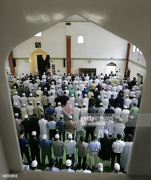 British muslims pray during Friday prayer at the East London mosque 15 July 2005 Whorshippers prayed for the victims of the four suicide bombs last...