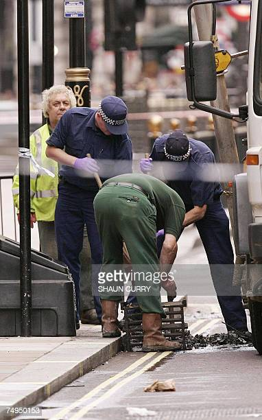 British police search the drains at Haymarket in central London 29 June 2007 after a car bomb was defused of gas cylinders petrol and nails in...