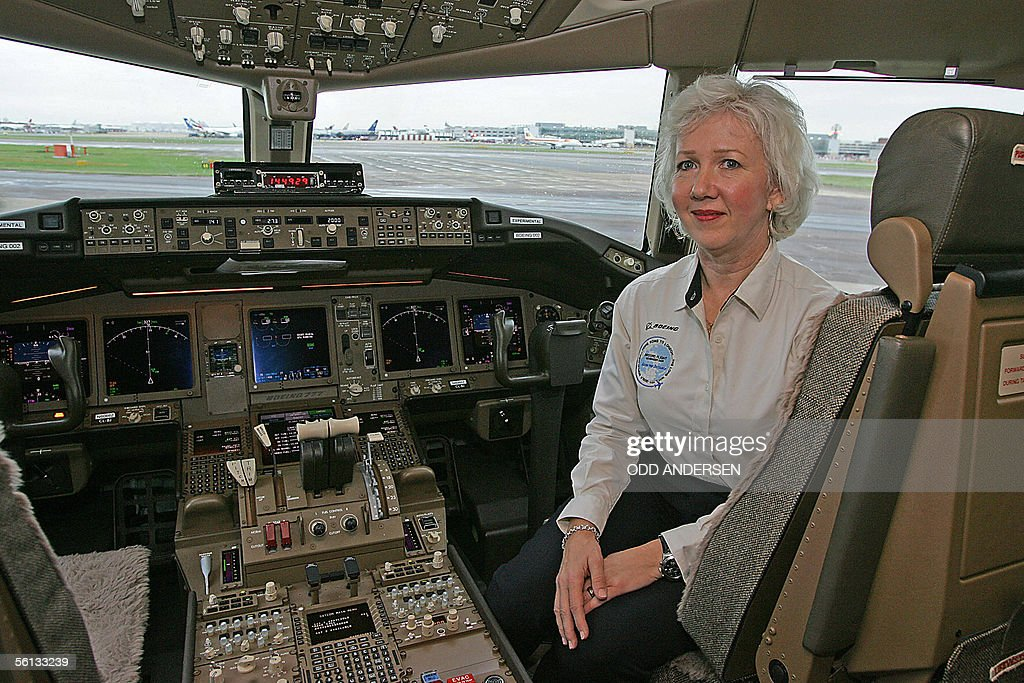Captain Suzanna Darcy-Henneman poses in the cockpit of a Boeing 777-200LR upon arrival at London's Heathrow airport 10 November 2005, after breaking the world record for the longest flight for a commercial jetsetting. The plane, carrying 35 passengers, touched down in west London following a 12,000-mile (20,100 kilometers) easterly-heading flight from Hong Kong, beating the existing non-stop passenger airline record of 10,823 miles achieved by another Boeing 777.