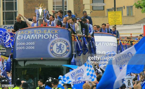 Chelsea captain John Terry and midfielder Frank Lampard hold the Premiership trophy aloft on an opentop bus during a parade in west London 14 May...