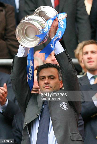 Chelsea manager Jose Mourinho lifts the FA Cup Trophy after beating Manchester United 10 at Wembley Stadium in London 19 May 2007 during the FA Cup...