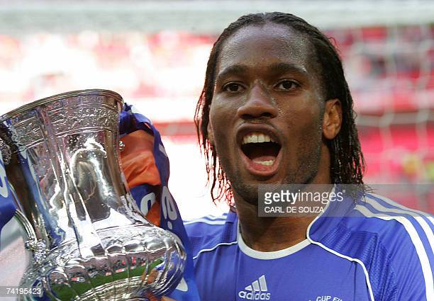 Chelsea's Didier Drogba celebrates with the FA Cup Trophy after his team beat Manchester United 10 at Wembley Stadium in London 19 May 2007 during...