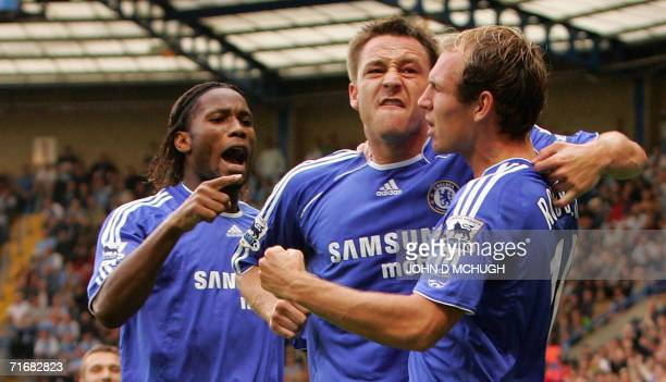 Chelsea's John Terry celebrates with teammates Didier Drogba and Arjen Robben after scoring against Manchester City during their first Premiership...