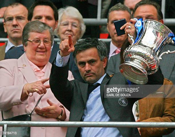 Chelsea's manager Jose Mourinho lifts the FA Cup after Chelsea beat Manchester United 10 at Wembley Stadium in London 19 May 2007 during the FA Cup...