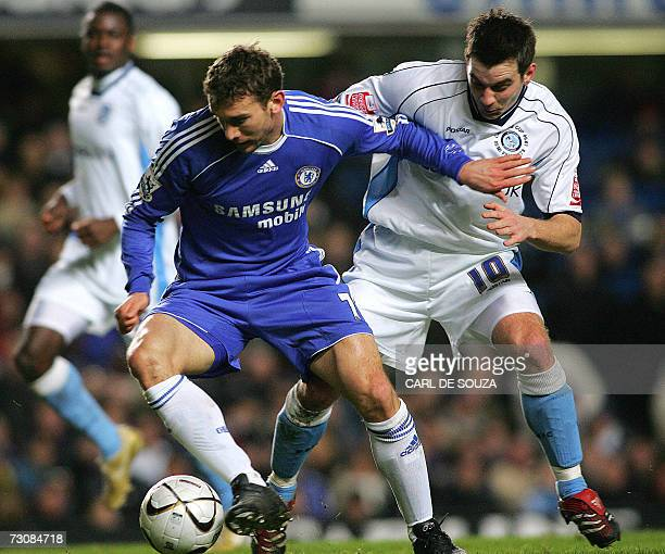 Chelsea's Ukrainian striker Andriy Shevchenko is challenged by Wycombe's Matt Bloomfield during their Carling Cup match at Stamford Bridge stadium in...