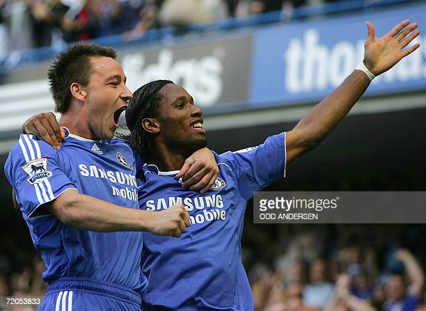 Didier Drogba of Chelsea celebrates his goal against Aston Villa with captain John Terry during their Premeirship game at Stamford Bridge in west...