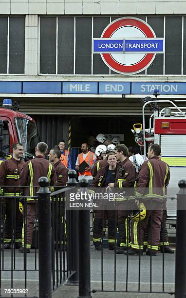 Emergency service workers gather outside Mile End underground station following the derailment of a Central Line train in the eastend of London 05...