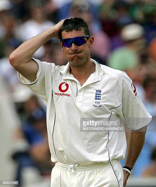 England bowler Ashley Giles reacts after bowling to Australia's Justin Langer on the second day of the fifth and final NPower Ashes Test match at the...