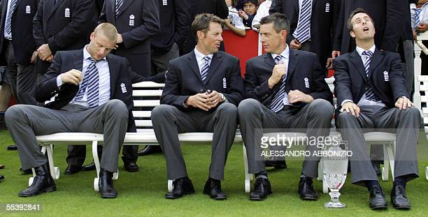 England cricketers Andrew Flintoff Marcus Trescothick Ashley Giles and captain Michael Vaughn sit at Lords cricket ground in London 13 September 2005...