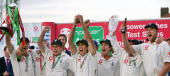 England's captain Michael Vaughan holds aloft the replica of the Ashes trophy flanked by teammates after defeating Australia in The Ashes in the...