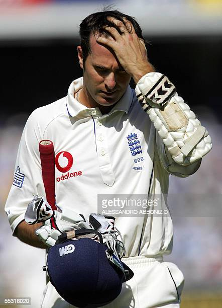 England's captain Michael Vaughn walks back to the Pavilion after losing his wicket to Australias Shane Warne for 11 runs on the first day of the...