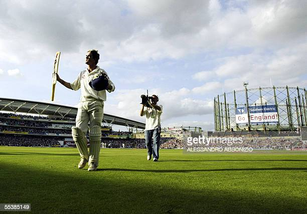 England's Kevin Pietersen acknowledges the crowds applause after finally losing his wicket to Australia's Glenn McGrath for 158 runs on the fifth day...