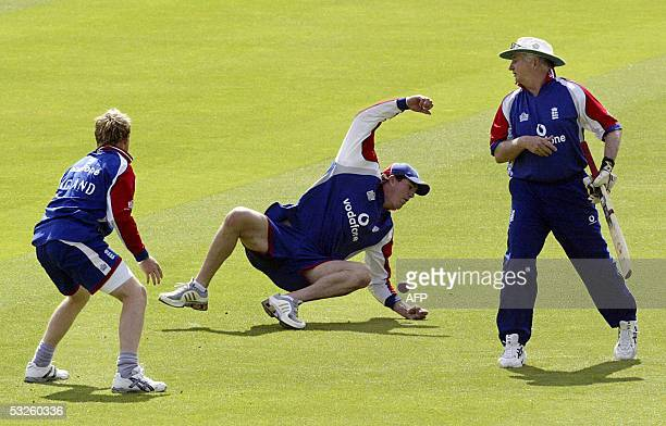 Englands Kevin Pietersen dives for a catch as Ian Bell and coach Duncan Fletcher look on at Lords cricket ground in London as the England team train...