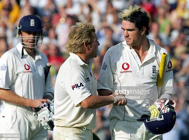 England's Kevin Pietersen shakes hands with Shane Warne of Australia as he leaves the field after being bowled out for 158 against Australia during...