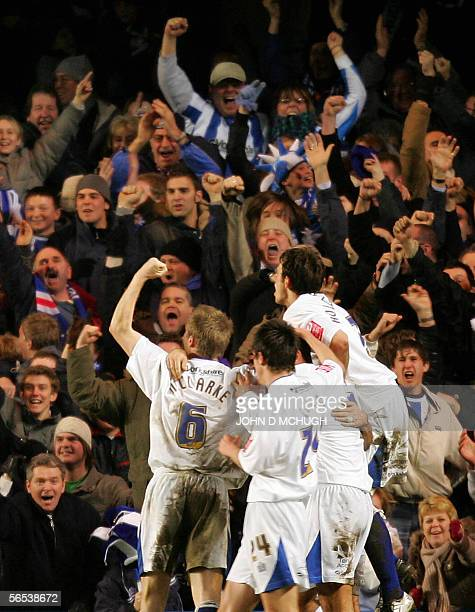 Huddersfield Town celebrate after Gary TaylorFletcher scored against Chelsea during their Third Round game of the FA Cup at Stamford Bridge in London...