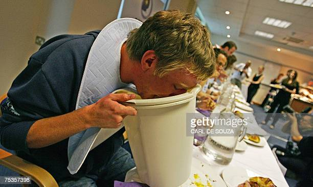 James Lawson Dingley vomits as he competes in the 'All You Can Eat Breakfast Championships' in central London 11 July 2007 Competitors had a time of...