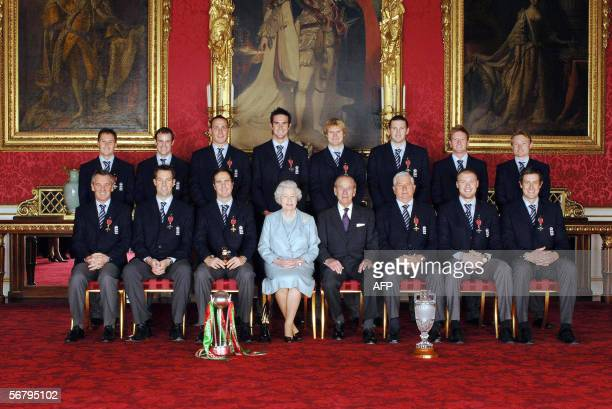 Members of England's 2005 Ashes winning Cricket team sit with Britain's Queen Elizabeth II and the Duke of Edinburgh in Buckingham Palace in London...