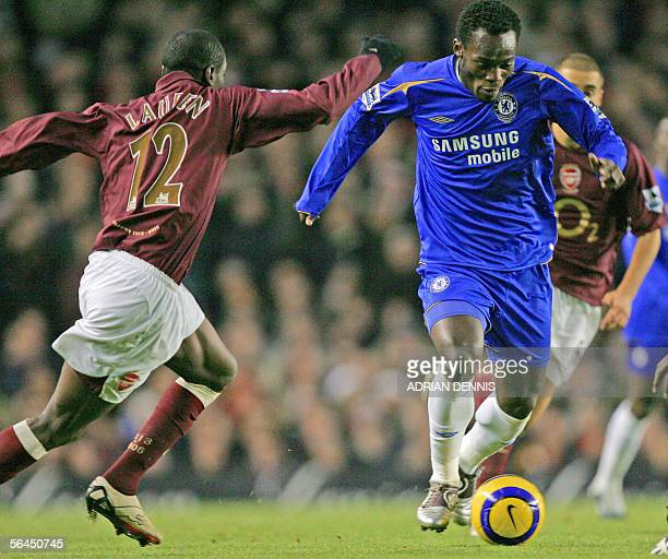 MIchael Essien of Chelsea is challenged by Lauren of Arsenal during a premiership match at Highbury in north London 18 December 2005 AFP PHOTO /...