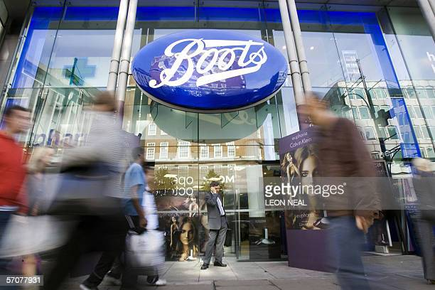 Passersby walk in front of a Boots Store on Oxford Street in London 03 October 2005 Boots Group the British health and beauty retailer announced...