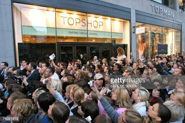 People gather outside a Top Shop store as they wait to catch a glimpse of British Supermodel Kate Moss as she promotes her new range of clothing...