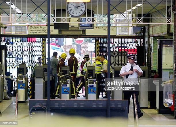 Police and fire personnel work in London's Aldegate East tube station after an explosion occurred in the subway line 07 July 2005 Police said they...