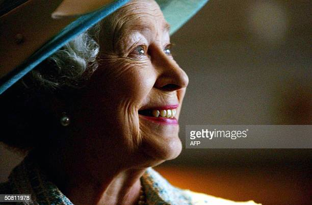 Queen Elizabeth II meets British Airways dignitaries during a visit to Heathrow Airport in London 07 May to mark the 10th anniversary of UNICEF and...