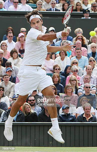 Roger Federer of Switzerland returns the ball to Juan Carlos Ferrero of Spain during their quarter finals of the Wimbledon Tennis Championships in...