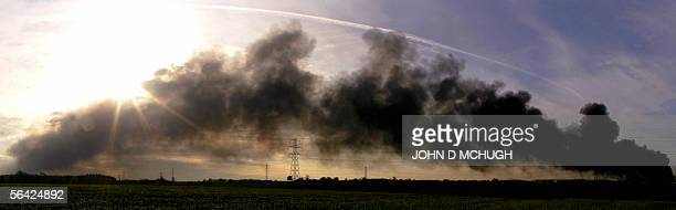 Smoke continues to pour into the sky as fire rages out of control for a third day in Hemel Hempstead north of London 13 December 2005 following an...