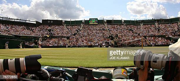 Spanish Rafael Nadal returns the ball to Swiss Roger Federer during the men's final at the Wimbledon Tennis Championships in Wimbledon in south...