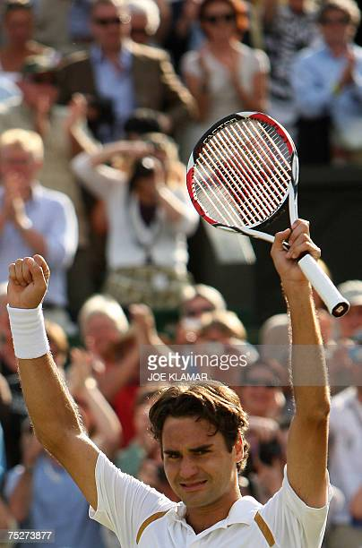 Swiss Roger Federer celebrates after defeating Spanish Rafael Nadal in men's final at the Wimbledon Tennis Championships in Wimbledon in south London...