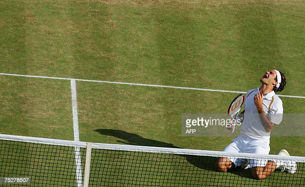 Swiss Roger Federer celebrates after defeating Spanish Rafael Nadal during the men's final at the Wimbledon Tennis Championships in Wimbledon in...