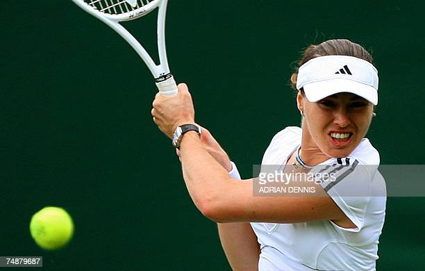 Switzerland's Martina Hingis returns the ball to British Naomi Cavaday during the first round of the Wimbledon Tennis Championships in Wimbledon in...