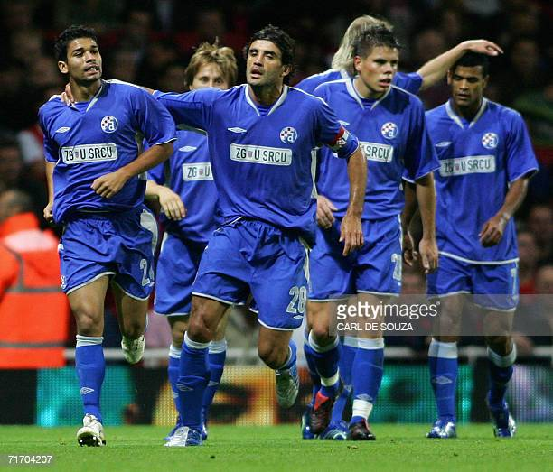 Team mates congratulate Dinamo Zagreb's Eduardo during their Champions League qualifying match against Arsenal in London 23 August 2006 AFP...