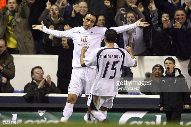 Tottenham's Bulgarian forward Dimitar Berbatov celebrates his first half strike with French midfielder Steed Malbranque during the UEFA Cup match...