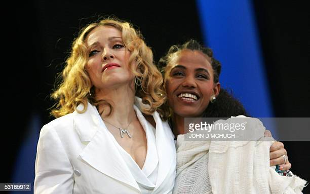 US pop singer Madonna introduces Birhan Woldu who appeared as a child close to death in videos at the original Live Aid concert at the Live 8 concert...