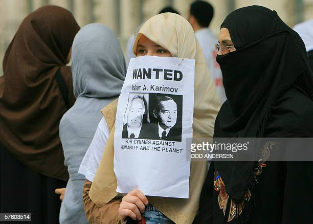 Uzbek women take part in demonstration outside No10 Downing street in London 13 May 2006 on the first anniversary of the killing of protestors by...