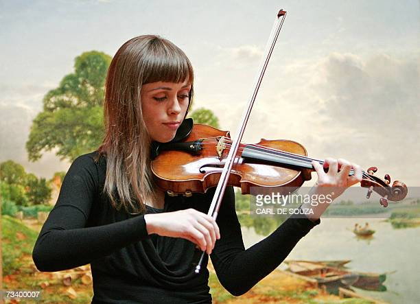 Violinist Ruth Palmer plays a 1729 Stradivari violin known as the 'Solomon ExLambert' at Christies auction house in central London 23 February 2007...