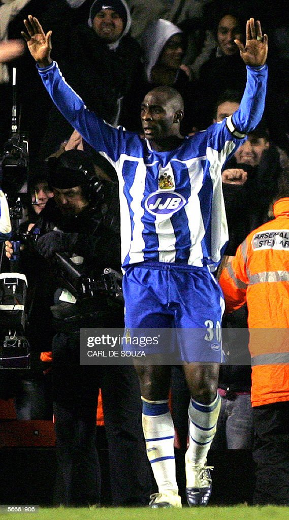 Wigan United Kingdom  city photos gallery : Wigan's Captain Jason Roberts celebrates after scoring against Arsenal ...