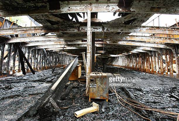 Workers' tools lie abandoned in the burnt hull of the Cutty Sark in east London 29 May 2007 A concert will take place to raise funds for the stricken...