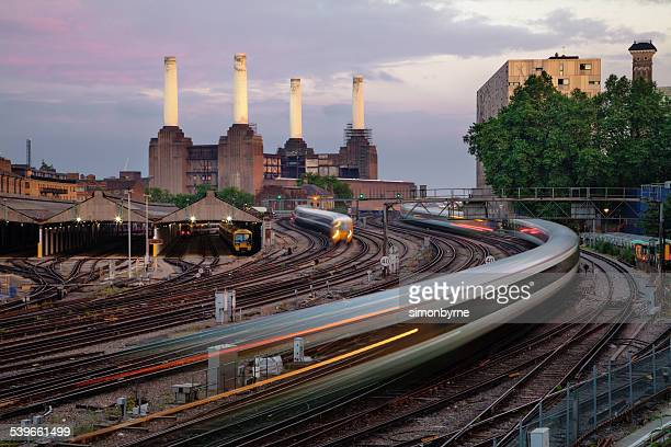 UK, London, View of railroad tracks, trains and Battersea Power Station