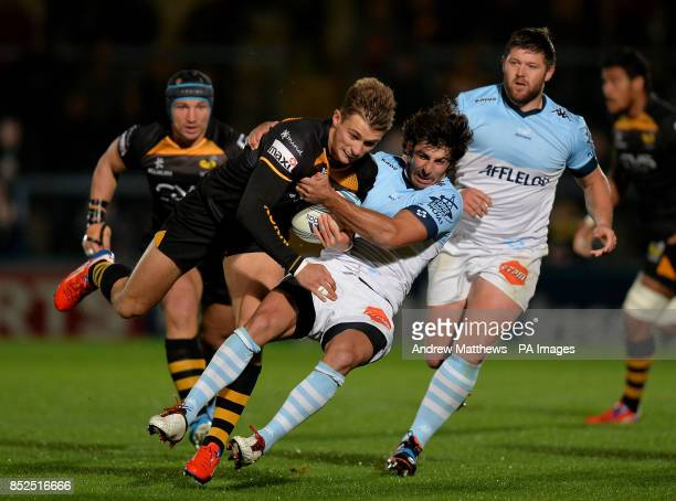 London Wasps' Josh Bassett is tackled by Bayonne's Mathieu Belie during the Amlin Challenge Cup Pool four match at Adams Park High Wycombe