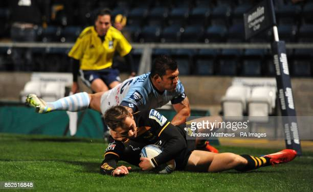 London Wasps' Josh Bassett scores his side's second try of the game during the Amlin Challenge Cup Pool four match at Adams Park High Wycombe