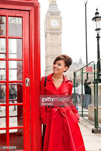 London Woman in Red Leaning on Phone Booth
